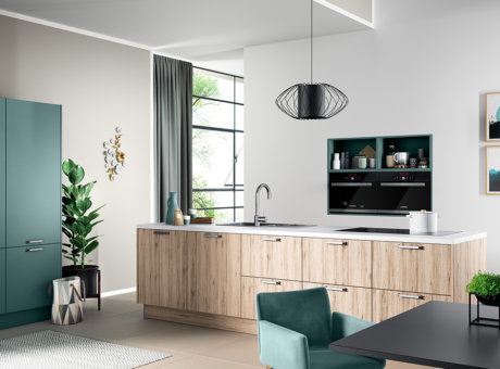 white and wood cabinets, with green/blue doors in the corner of the picture